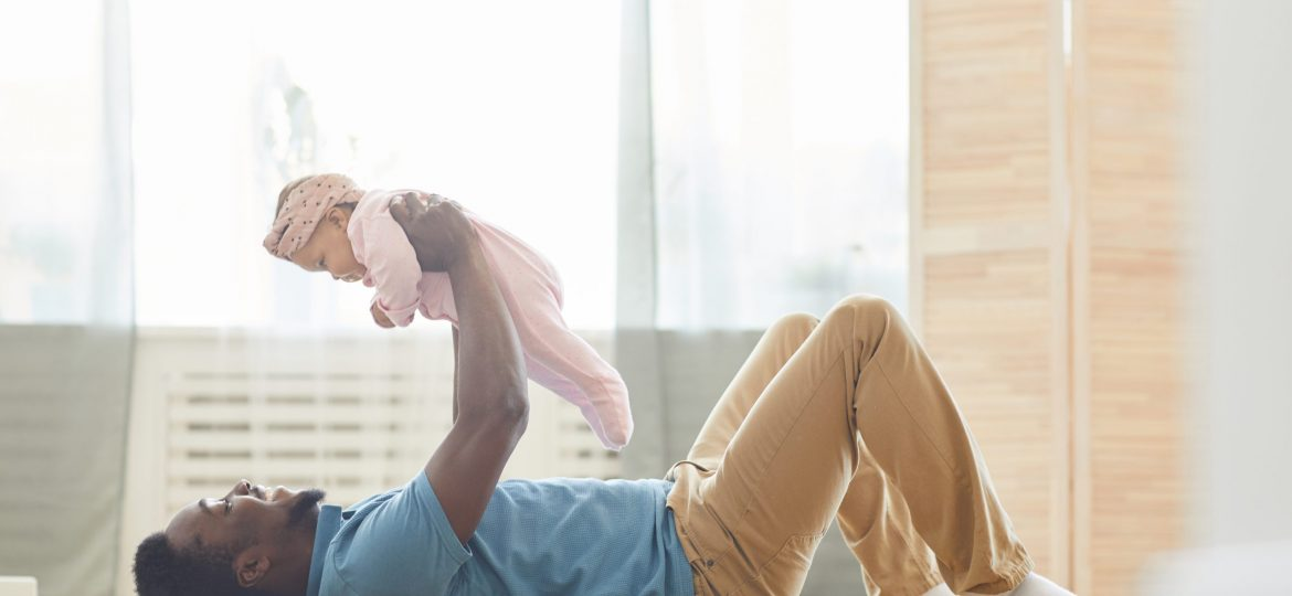 Father exercising with baby